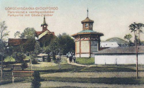 Görgénysóakna Gyógyfürdő:park részlet a vendég szobákkal.1916