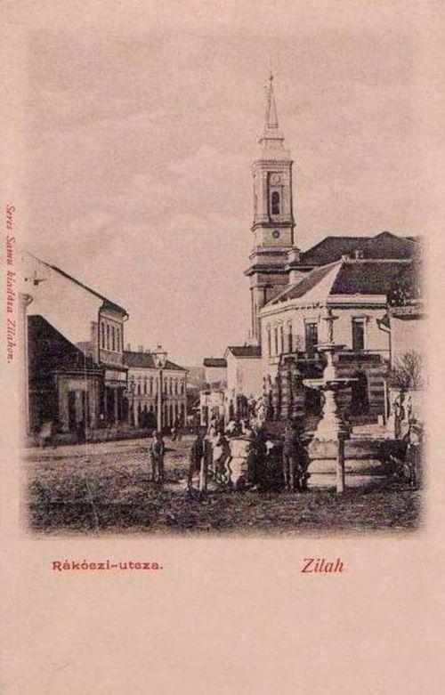 Zilah:Rákóczi utca,kút,templom.1903