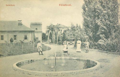 Félixfürdő:szőkőkút a parkban,háttérben a Gyógyszertár.1909